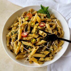 A fresh, seasonal, easy to make pesto pasta that's nut free and dairy free.