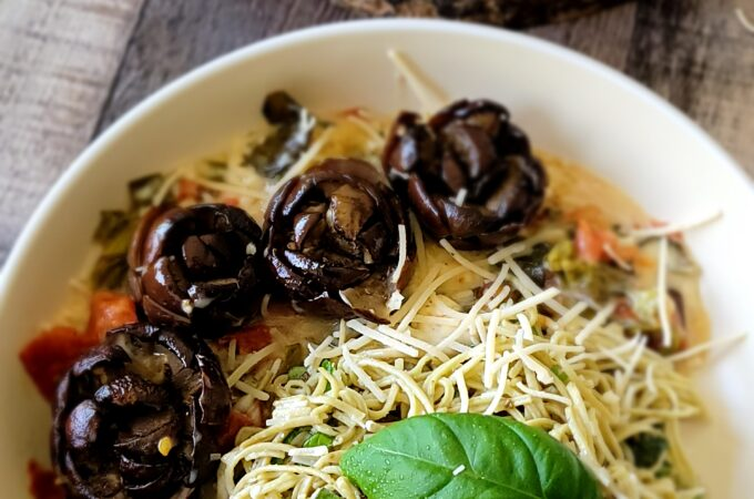 You can serve the eggplant flowers with pasta and the cheesy sauce from the bottom.