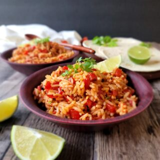 A picture of a table set with Mexican Rice.