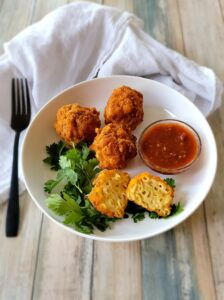 A plate of Fried Mac and Cheese Balls